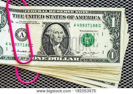 Dollar banknotes with pink clip stapled dollar money