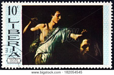 LIBERIA - CIRCA 19669: a stamp printed in Liberia shows David and Goliath Painting by Carvaggio circa 1969
