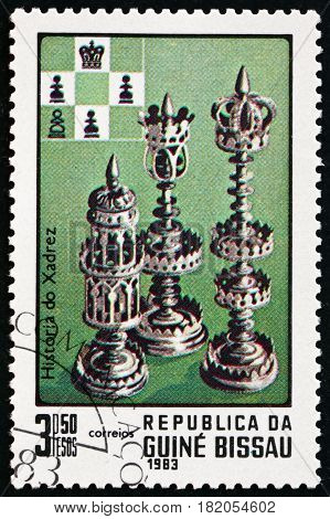 GUINEA-BISSAU - CIRCA 1983: a stamp printed in Guinea-Bissau shows Chess Pieces History of Chess circa 1983