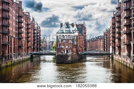 Beautiful View Of Famous Speicherstadt Warehouse District With Dark Clouds Before The Storm In Hambu