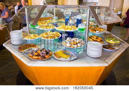 Sharm El Sheikh, Egypt - April 8, 2017: The people choose food in the buffet restaurant at luxury hotel Barcelo Tiran Sharm 5 stars at Sharm El Sheikh, Egypt on April 8, 2017