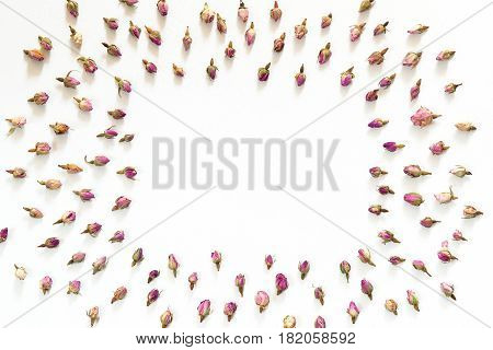 Floral pattern made of pink and beige roses on white background. Flat lay, top view. Valentine's background. Floral pattern. Pattern of flowers. Flowers pattern texture