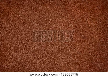 Old dark brown varnished wood close up. Texture and background