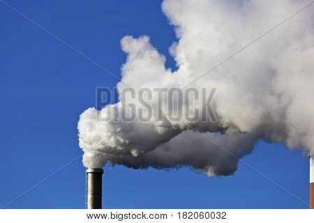 smoking chimneys of a factory
