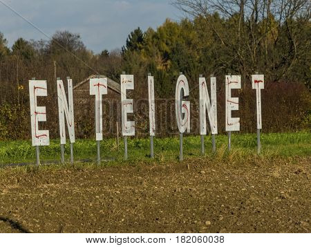 lettering expropriates on a field