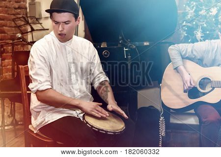 Stylish Percussionist Playing On Leather Drum On A Concert, Hands Motion
