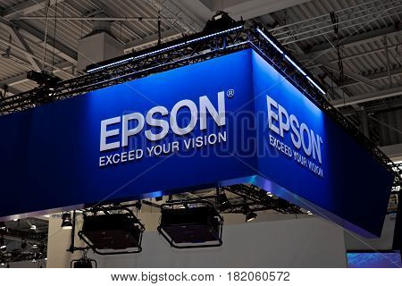 Hannover, Germany - March, 2017: Epson company logo sign on exhibition fair Cebit 2017 in Hannover Messe, Germany