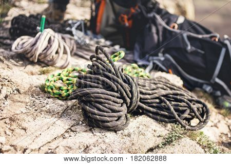 Rope for Recreational Activity A neatly folded climbing rope lies on a rock