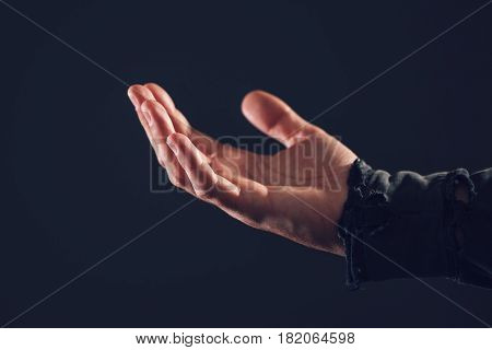 Poor male beggar asking for charity money and help close up of hand