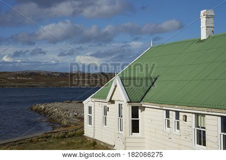 STANLEY, FALKLAND ISLANDS - JANUARY 14, 2017: Gilbert House; home to the Office of the Legislative Assembly of the Falkland Islands. White building with green roof in Stanley, capital of the Falklands