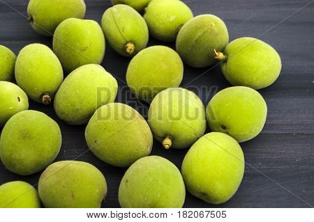 Green apricot pictures, immature sour apricots, the most beautiful and the most sour green.