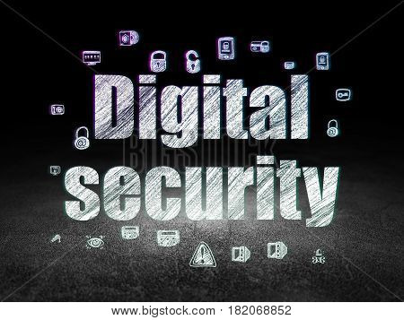 Privacy concept: Glowing text Digital Security,  Hand Drawn Security Icons in grunge dark room with Dirty Floor, black background