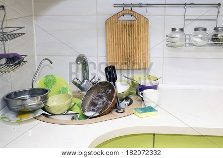 A bunch of dirty dishes in the kitchen