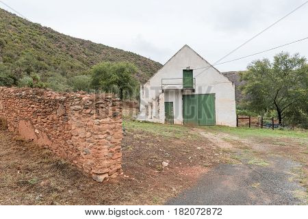 OUDE MURAGIE SOUTH AFRICA - MARCH 24 2017: A barn next to the Oude Muragie road between De Rust and the Cango Caves in the Western Cape Province of South Africa