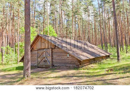 RIGA LATVIA - JUNE 13 2016: Threshing house (circa 19th c.) of Patmalnieki village in Latvia. Exhibited in Ethnographic Open-Air Museum of Latvia since 1990
