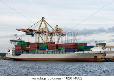 Maritime transportation industry. Container transshipment at port.