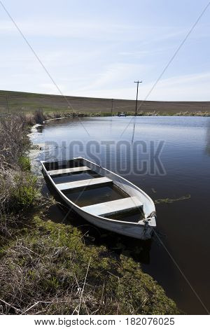 Row boat in a pond in eastern Washington.