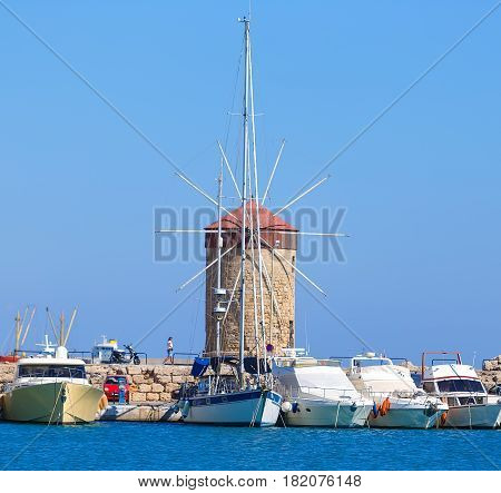 beautiful medieval Windmill of Mandraki Harbor in Rhodes as majestic reminders of times