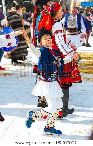Razlog, Bulgaria - January 14, 2017: Boy dancing in bulgarian traditional clothing at the festival