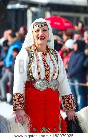 Razlog, Bulgaria - January 14, 2017: Lady in bulgarian traditional clothing at the festival