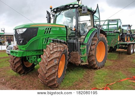farm tractor standing in a muddy field