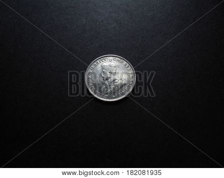 Vintage and antique Australian silver One Shilling coin.