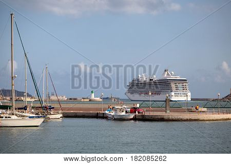 A cruise liner sailing from the port of Cartagena, Spain