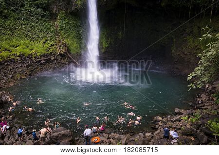 La Fortuna Waterfall Costa Rica - March 31 2014: People swimming at the pool of the La Fortuna Waterfall in Costa Rica.