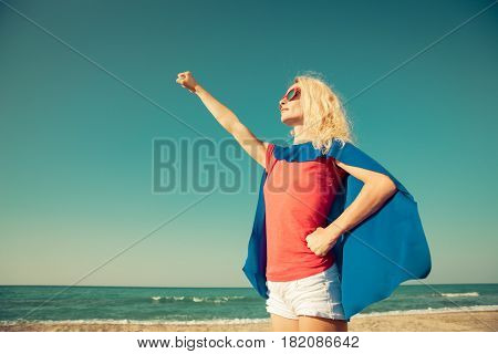 Superhero Woman On The Beach. Summer Vacation Concept