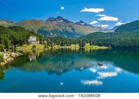 Beautiful view at St.Moritz lake with clouds reflected in water