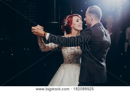 Happy Bride And Stylish Groom Dancing At Wedding Reception. Gorgeous Wedding Couple Performing  Firs