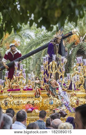 Jesus of Nazareth carrying wooden cross Throne more popular in this city represents jesus bearing the cross to Mount Calvary to be crucified Linares Andalusia Spain