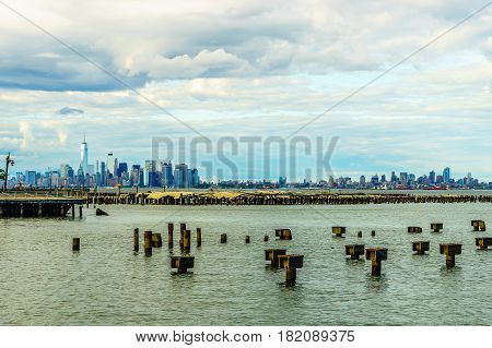 Lower Manhattan skyline seen from Staten Island with a metal piles