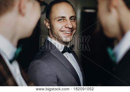Stylish Groom Laughing And Having Fun With Groomsmen While Getting Ready In The Morning For Wedding