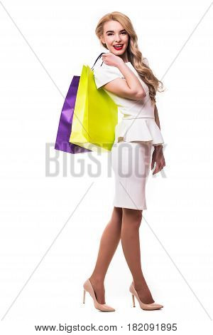Portrait Of An Young Woman Holding Several Shoppingbag On White Background.