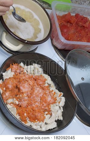 Preparation Of Tomato Soup. Fry Chicken And Carrots. Next In A Saucepan Are Cooked Pasta. Tomato In