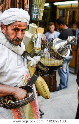 CAIRO, EGYPT - MAY 21, 2016: An sherbet seller in the historical Khan El-Khalili Souq marketplace is one of the tourist magnets in Capital City Cairo, Egypt.