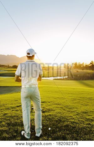 Male Golfer Standing At Tee Square On Course.