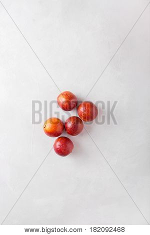 Sicilian orange on light abstract background. Sicilian orange. Citrus fruits. Mixed festive colorful tropical and citrus fruit. Healthy eating photo concept. Copyspace