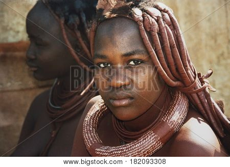 Khorixas, Namibia-April 17th 2017: picture of 2 women of the Himba tribe.