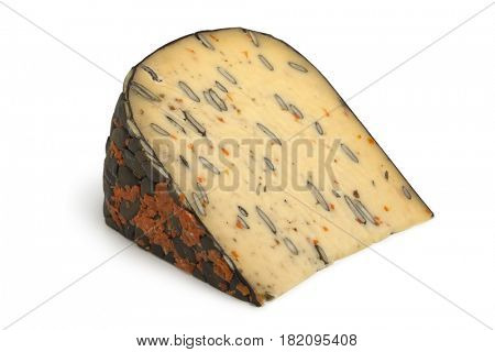 Dutch cheese with pumpkin seeds and carrot on white background
