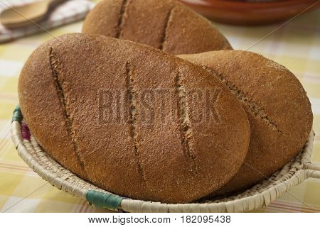 Basket with fresh baked moroccan brown bread