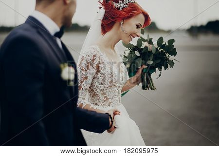 Stylish Bride And Groom Walking And Smiling,  With Boho Bouquet. Luxury Wedding Couple Newlyweds, Ha