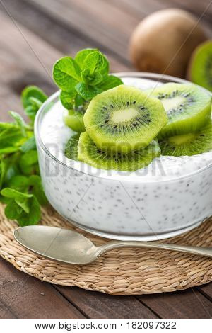 Fresh kiwi yogurt with fruits and chia seeds healthy breakfast