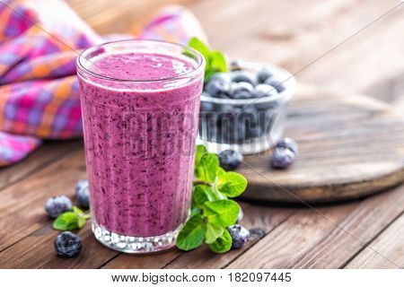 Yogurt or smoothie with fresh blueberry closeup