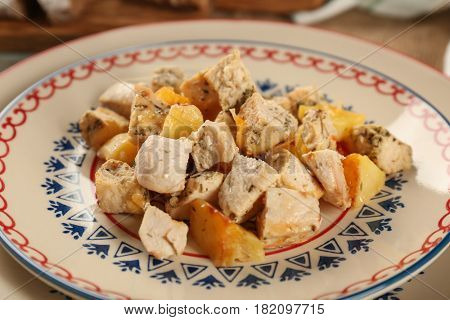 Chicken ragout with potato on plate, closeup