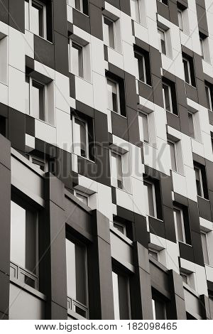 Unusual office building with staggered windows close-up