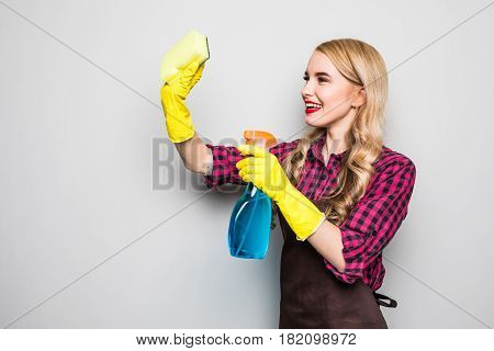 Cleaning Lady. Woman Cleaning Scrubbing And Polishing Reaching And Stretching With Cleaning Cloth An