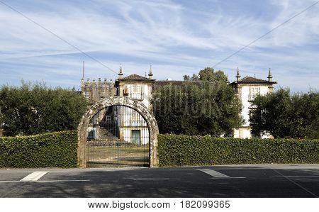 BERTIANDOS, PORTUGAL - OCTOBER 7, 2016: Main gate to the Solar de Bertiandos a Portuguese baroque manor seen from the road near Ponte de Lima Northern Portugal