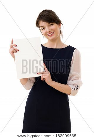 Portrait of young pretty business woman in white and blue suit shows piece of paper isolated on white background.